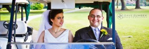 Newly Weds sitting in a golf cart.