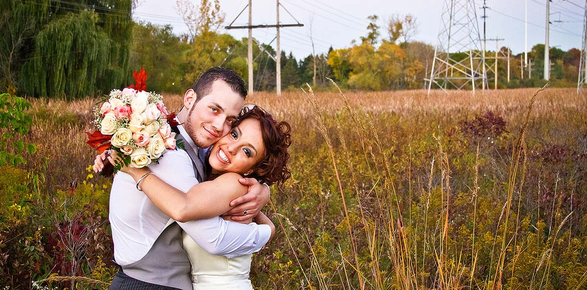 Newly Weds in a Scenic field on their wedding day in Waukegan, IL